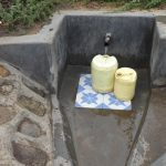 The Water Project: Masera Community A -  Jerricans Fill With Clean Water