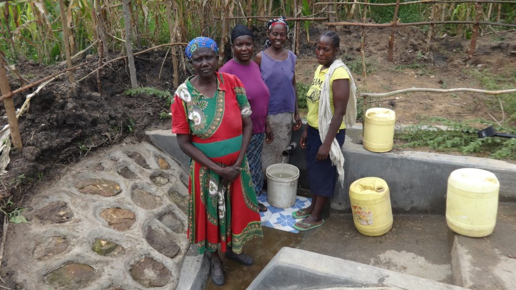 The Water Project : kenya18112-posing-in-front-of-protected-spring