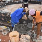 The Water Project: Mbuuni Secondary School -  Building Up Tank Wall