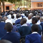 The Water Project: Mbuuni Secondary School -  Students Listen To Training Outside