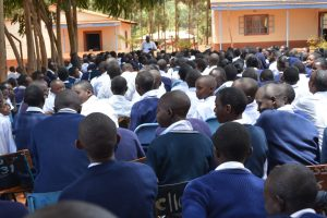 The Water Project:  Students Listen To Training Outside