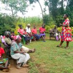 The Water Project: Mwituwa Community, Nanjira Spring -  Community Members Listen During Traing