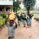 The Water Project: Shitaho Primary School -  Students Fetching Water For Construction