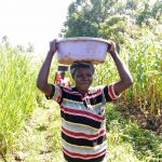 The Water Project: Burachu B Community -  Carrying Materials To The Spring