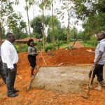 The Water Project: Shitaho Primary School -  Artisan Explaining Latrine Construction To Board Members
