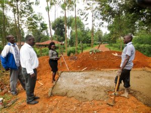 The Water Project:  Artisan Explaining Latrine Construction To Board Members