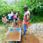 The Water Project: Ulagai Community -  Transporting Construction Materials