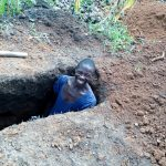 The Water Project: Ejinja Community, Anekha Spring -  A Community Member Preparing A Pit For His New Sanitation Platform