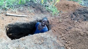 The Water Project:  A Community Member Preparing A Pit For His New Sanitation Platform