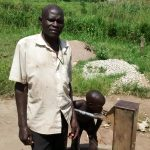 The Water Project: Nyakarongo Community -  Water Point Chairman Asiimwe Perez