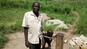 The Water Project:  Water Point Chairman Asiimwe Perez