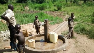 The Water Project:  Using The Rehabilitated Well