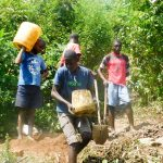 The Water Project: Ulagai Community, Aduda Spring -  Transporting Construction Materials