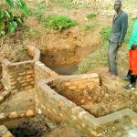 The Water Project: Musango Community A -  Spring Protection Construction