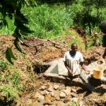 The Water Project: Mwituwa Community A -  Filling Behind The Spring Protection
