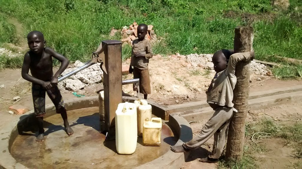 The Water Project : 13-uganda18297-water-flowing