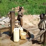 The Water Project: Nyakarongo Community -  Water Flowing