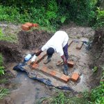 The Water Project: Mbande Community -  Spring Protection Construction