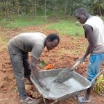 The Water Project: Lwangele Community, Machayo Spring -  Mixing Cement