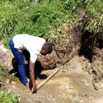 The Water Project: Ejinja Community, Anekha Spring -  Field Officer Jemmimah Confirms Measurements For The Spring