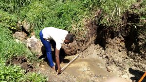 The Water Project:  Field Officer Jemmimah Confirms Measurements For The Spring