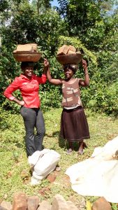 The Water Project:  Women Carrying Materials To The Artisan