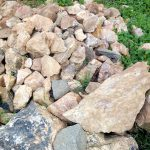 The Water Project: Muraka Community A -  Stones Gathered For Spring Protection