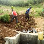 The Water Project: Musango Community A -  Planting Grass Behind Spring