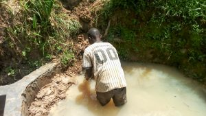 The Water Project:  Filling Up The Source Area With Stones