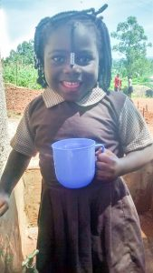 The Water Project:  Little Nulin Kayeshe Shares Her Joy By Smiling After Trying Water From The Tank