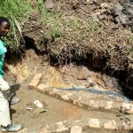 The Water Project: Ejinja Community -  Spring Protection Construction