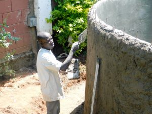 The Water Project:  Artisan Working On The Wall