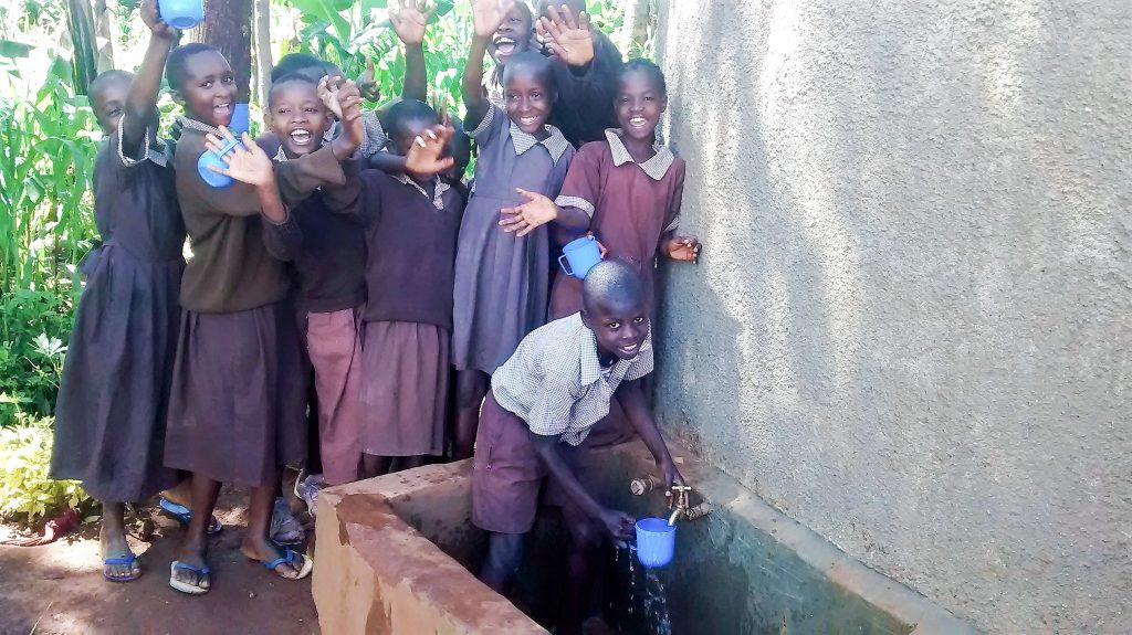 The Water Project : 21-kenya18018-indeche-erickson-leading-a-team-of-pupils-to-celebrate-clean-water