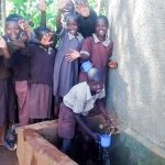 The Water Project: Mwanzo Primary School -  Indeche Erickson Leading A Team Of Pupils To Celebrate Clean Water