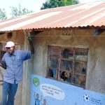 The Water Project: Eshiamboko Primary School -  Artisan Installing Gutter System