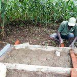 The Water Project: Burachu B Community, Shitende Spring -  Sanitation Platform Construction