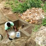 The Water Project: Ejinja Community, Anekha Spring -  Spring Protection Construction