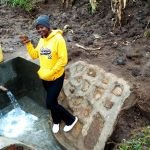 The Water Project: Burachu B Community -  Field Officer Jemmimah At Finished Spring