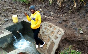 The Water Project:  Field Officer Jemmimah At Finished Spring