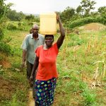 The Water Project: Musango Community A -  Carrying Water Home