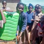 The Water Project: Mwanzo Primary School -  Sara Demonstrating Handwashing