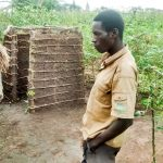 The Water Project: Nyakarongo Community -  Kyabona Godfrey A Community Member In Front Of His New Bath Shelter