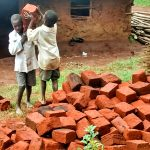 The Water Project: Mwanzo Primary School -  Shuttling Bricks