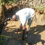 The Water Project: Mwituwa Community, Nanjira Spring -  Setting The Foundation