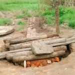 The Water Project: Nyakarongo Community -  Taking Apart The Well To Clean It Out And Protect It