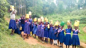 The Water Project:  Posing With Jerrycans