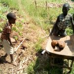 The Water Project: Musango Community A -  Children Helping Deliver Materials To Artisan