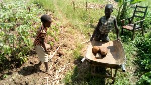 The Water Project:  Children Helping Deliver Materials To Artisan