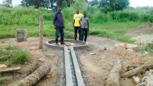 The Water Project:  Dan And The Crew After Finishing The Well Pad