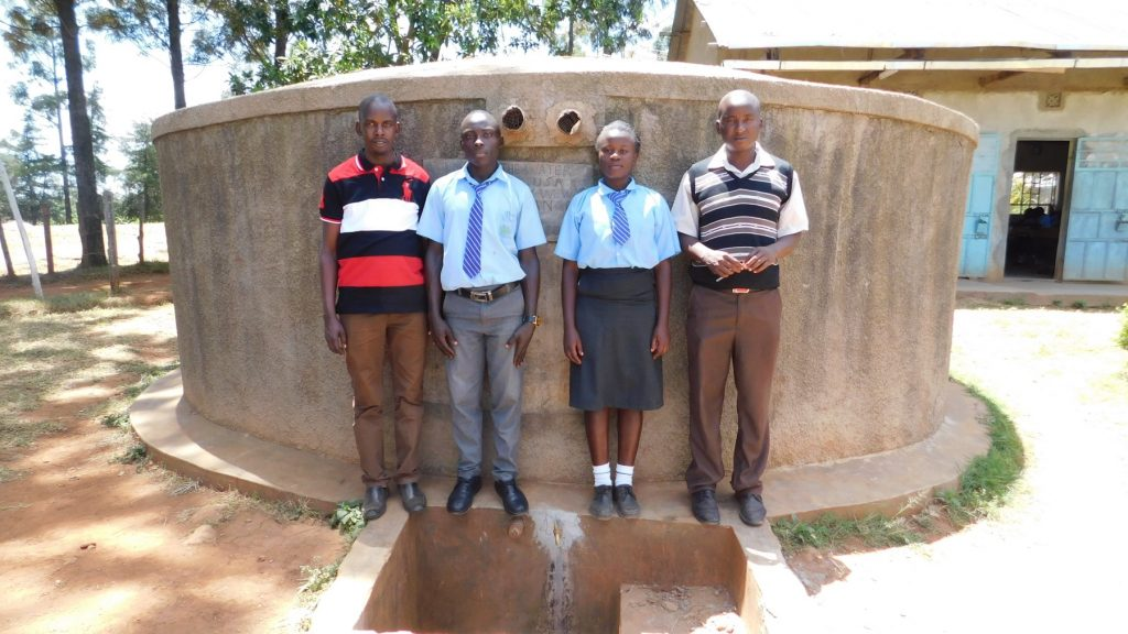 The Water Project : kenya4643-posing-with-tank